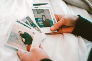 Image of person holding poloroid pictures