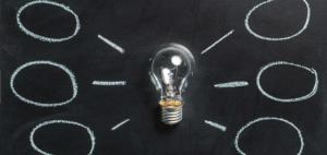 Chalkboard lightbulb with multiple ideas