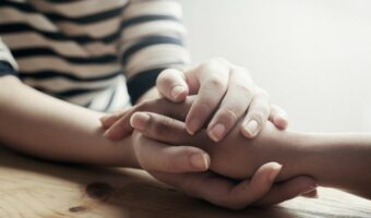 social support- two people holding hands