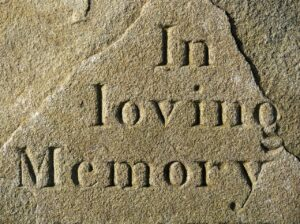"""Tombstone with """"in loving memory""""-grief and loss of parent"""