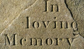 """Tombstone with """"in loving memory"""""""
