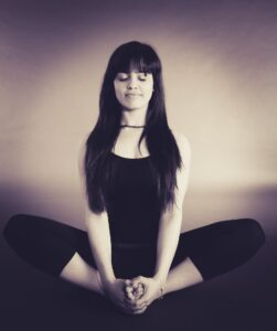 Woman meditating to develop mindfulness for teen anxiety