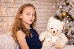 Girl at christmas with teddy bear