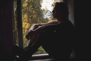 man in window, drug addiction