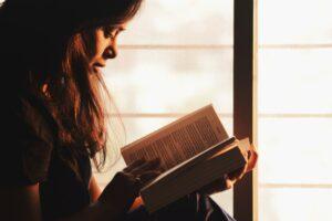 reading depression books in sunlight